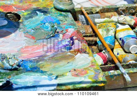 Artistic Brush Lies On The Palette With Colorful Paints