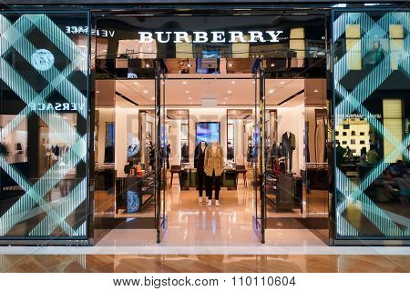 SINGAPORE - NOVEMBER 08, 2015: entrance to Burberry store. Burberry Group plc is a British luxury fashion house, distributing outerwear, fashion accessories, fragrances, sunglasses, and cosmetics