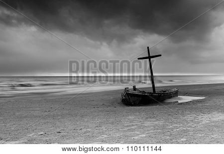 Wrecked Boat On The Beach With Storm Cloud