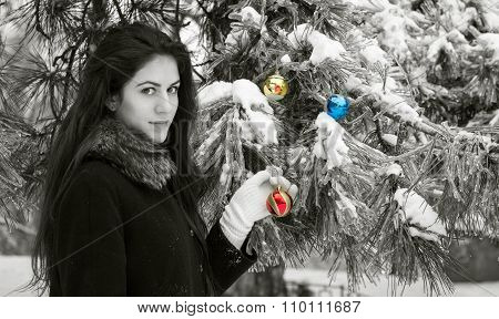 Femalel Decorates A Fir Tree