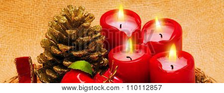 Four red candlesand decoration.