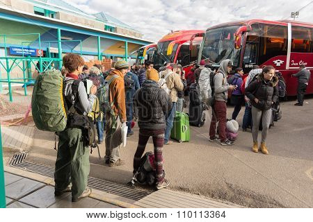 Travelers Waiting For Boarding Autobus In Puno, Peru