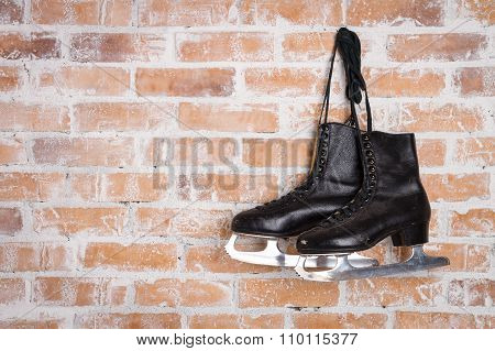 Old Black Figure Ice Skates Hanging