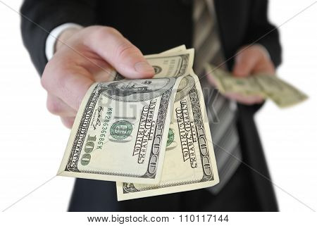 A Man In A Business Suit Offers Money