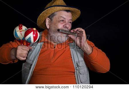 Senior musician with mouth-organ and maraca