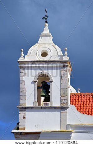 The historical Santa Maria Church bell tower in Lagos
