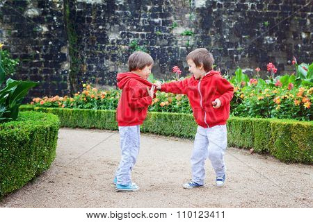 Two Kids, Boy Brothers, Fighting In Garden, Summer