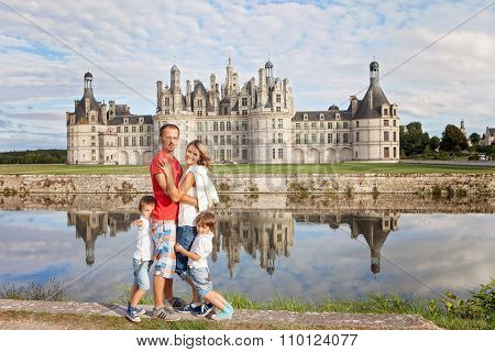 Happy Family On Chambord Chateaux, Enjoying Summer Holiday