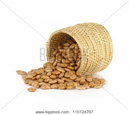 Pinto Beans Spilled From Basket Isolated On White Background
