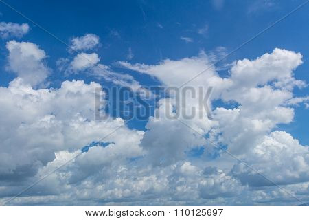 white clouds with blue sky before a spring rainstorm