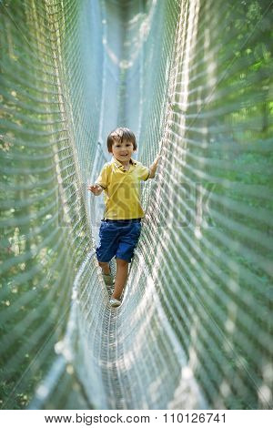 Cute Child, Boy, Walking In A Rope Playground Structure,