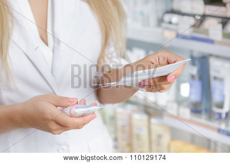 Pharmacist checking the prescription