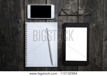 Office Concept With Blank Screens On Wooden Background