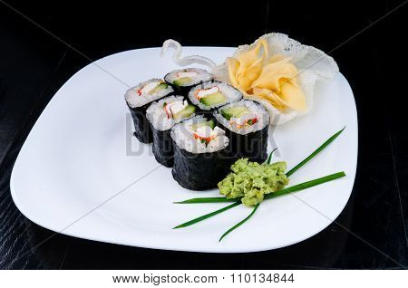 Sushi served on a white plate