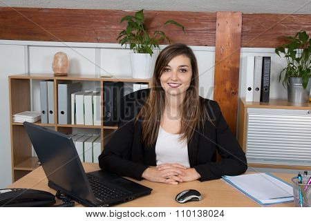 Businesswoman Working In Front Of Her Laptop In A Side View Shot