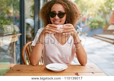 Pretty Young Girl Drinking Coffee