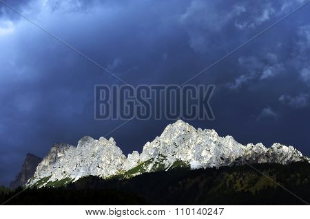 Stormy clouds over Croda da Lago, one of beautiful mountains in italian Dolomites