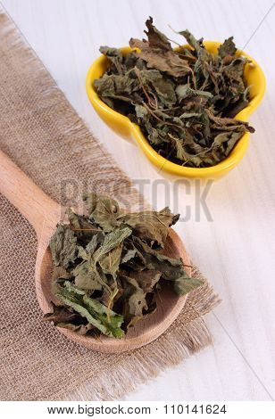 Dried Lemon Balm With Spoon And Bowl On Wooden Table, Herbalism