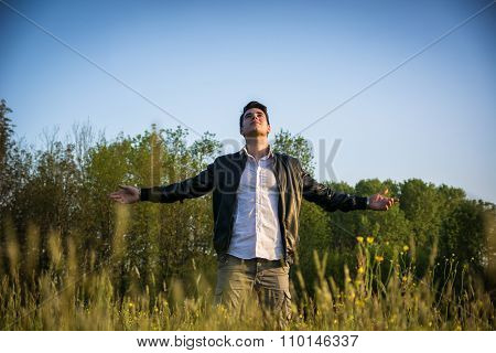 Young man celebrating nature and freedom