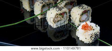 Uramaki sushi on a black plate