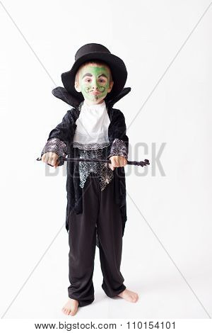 Cute Boy With Painted Face As A A Magician And Dressed In Magician Costume, Having Fun