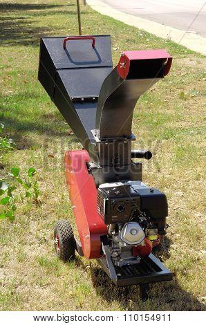 A garden shredder with a petrol engine