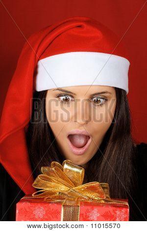 Santa Claus Girl With Christmas Present
