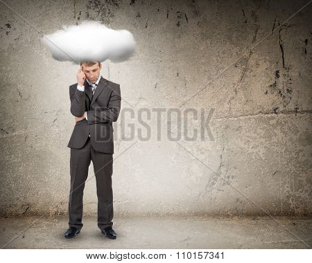 Sad businessman with cloud above head, front view