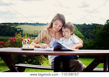 Mother And Son, Reading A Book Outdoor, Summer Day