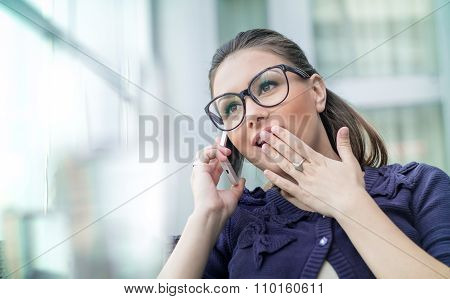 Astonished Woman On Phone