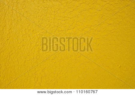 Old Shrunken Yellow Paint Covered Surface As Background