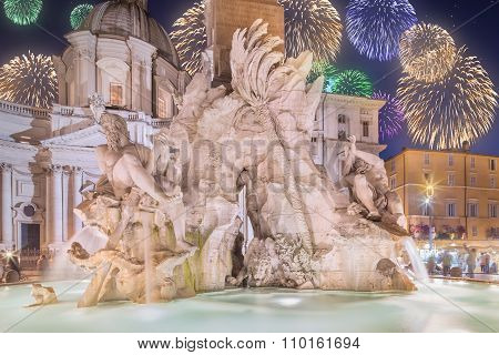 Beautiful fireworks above fountain of the Four Rivers in Piazza Navona