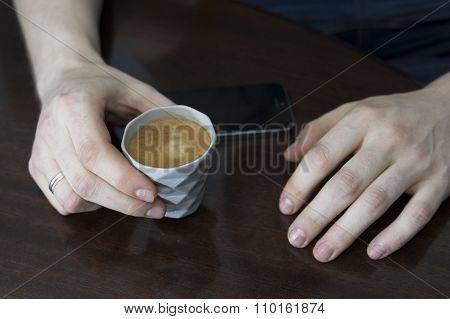 Hands With A Coffee Cup