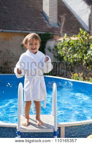 Little Cute Boy In A Big Swimming Pool