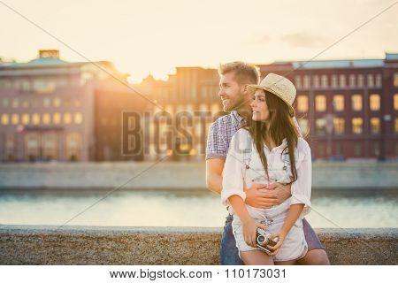 Beautiful couple of tourists outdoors