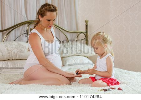 Pregnant Woman And Her Daughter.