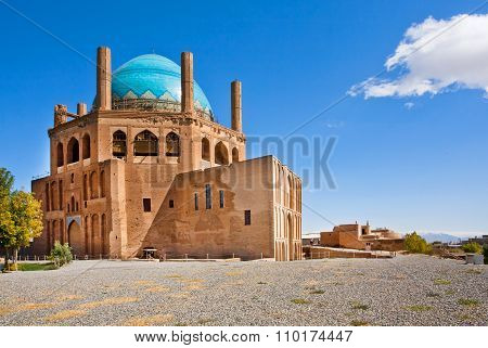 Blue Domed Ancient Building Of Mausoleum Dome Of Soltaniyeh Under The Clear Sky With Cloud. Iran.