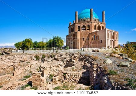 Ruins Of Stone Citadel And Historical Mausoleum Dome Of Soltaniyeh Background. The Structure, Erecte