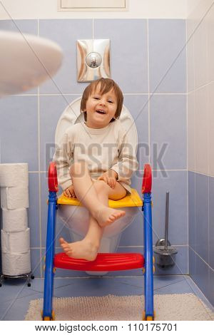 Little Boy, Sitting On The Toiled, Laughing