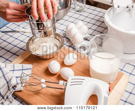 Sift Flour Man, Standing Behind A Table