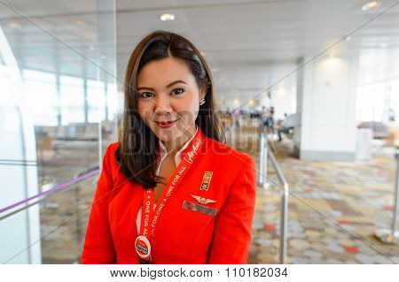 SINGAPORE - NOVEMBER 04, 2015: AirAsia crew member in Changi International Airport. AirAsia is a Malaysian low-cost airline headquartered near Kuala Lumpur, Malaysia