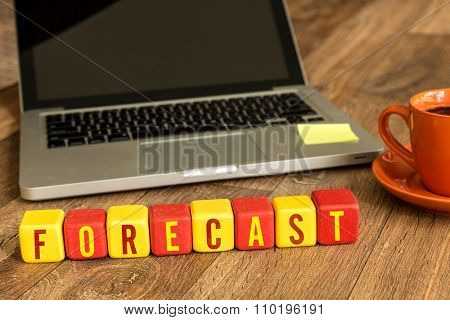 Forecast written on a wooden cube in a office desk