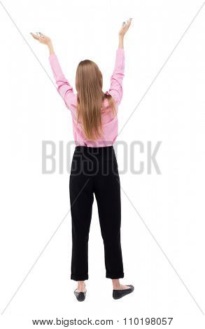 Back view business woman. Raised his fist up in victory sign. Raised his fist up in victory sign. Isolated over white background. The girl office worker in black trousers held up her hands to heaven