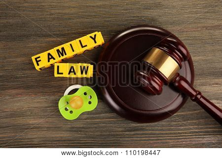 A gavel, a dummy and blocks regarding child-custody and divorce concept