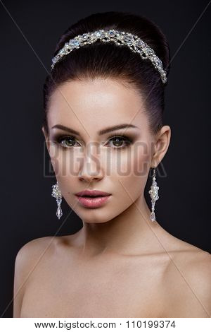 Beautiful Brunette Girl With Perfect Skin, Evening Make-up, Wedding Hairstyle And Accessories. Beaut