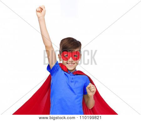 carnival, childhood, power, gesture and people concept - happy boy in red super hero cape and mask showing fists