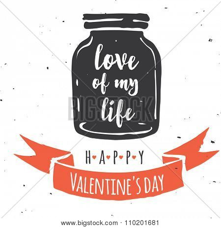 mason jar with heart, love quote on the black chalkboard