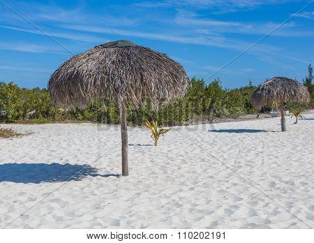 Beach Umbrella made of palm leafs on exotic beach