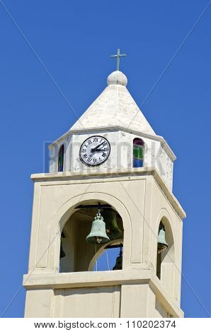 Church Bellfry With Clock Against Blue Sky