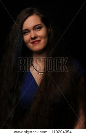 portrait of the beautiful young girl with long dark hair